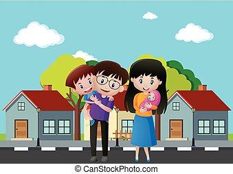 Familiares frente a la casa