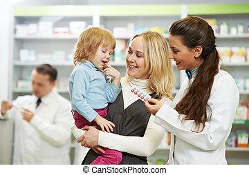 Farmacia química, madre e hijo en la farmacia