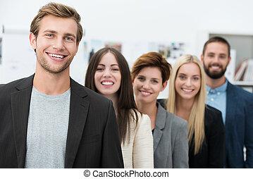Feliz equipo de negocios motivados