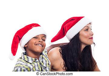 Feliz familia con sombrero de Navidad