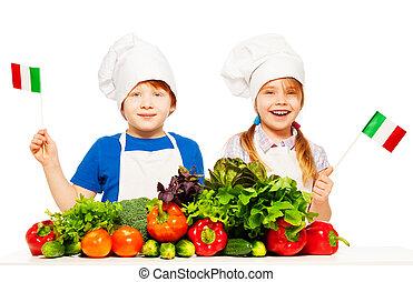 Feliz joven italiano cocina con verduras verdes