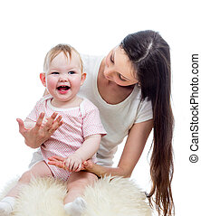 Feliz juego de madre y bebé