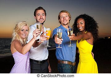 Fiesta con champaña en la playa