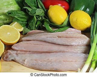 Filetes de pescado Barramundi con limones