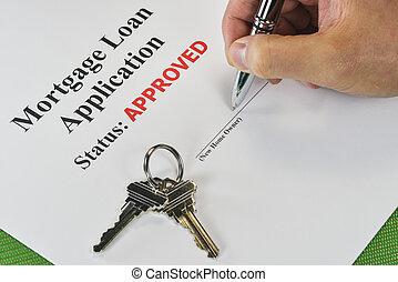 Firmando a mano un préstamo de bienes raíces