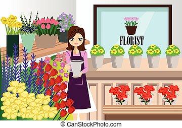 Florista trabajando con un montón de flores diferentes