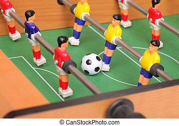 Foosball mesa de fútbol. Jugadores de fútbol del equipo de deportes