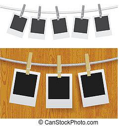 Fotos con alfileres en la cuerda