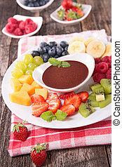 Fruta y salsa de chocolate