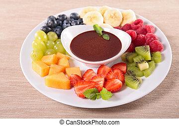 Frutas y salsa de chocolate