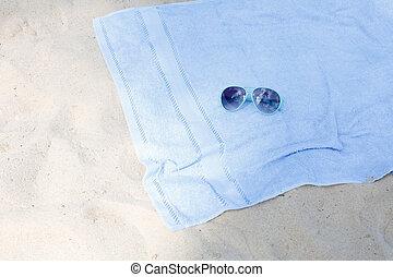 Gafas y toallas