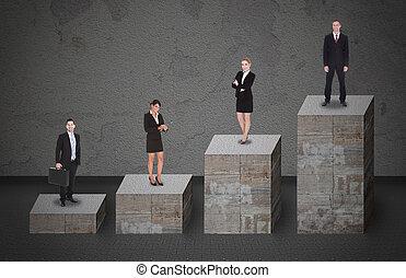 Gente de negocios parada en el gráfico de barras