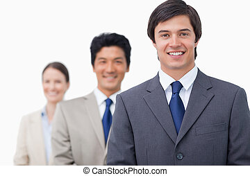 Gente de negocios sonriente en una fila