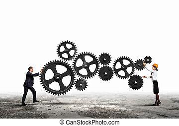 Gente de negocios y elementos de mecanismo