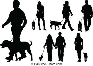 Gente paseando perros