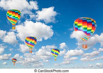 Globos de aire caliente sobre nubes blancas y suaves en el cielo azul