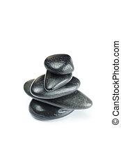 Grandes piedras de spa negras aisladas en blanco