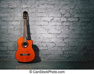 Guitarra acústica apoyada en la pared grungy