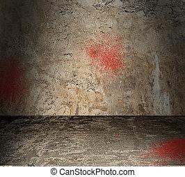 Habitación de concreto vacía con salpicaduras de sangre