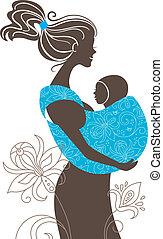 Hermosa madre silueta con un bebé en un trineo