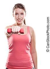 Hermosa mujer deportiva con pesas