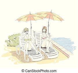 Hermosas chicas elegantes en trajes de baño se acuestan en el salón de chaise cerca de la piscina y beben cócteles