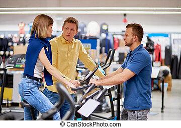 hermoso, bicicleta, tienda, comprar, ropa de deporte, necesidad, ejercicio, pareja
