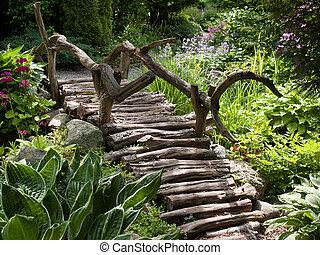Hermoso paisaje de jardín, puente de pie de madera