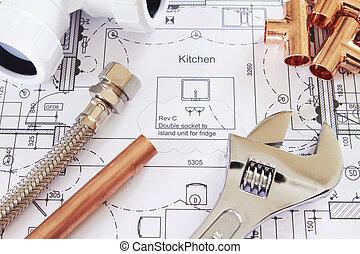 Herramientas de plomería arregladas con planos domésticos