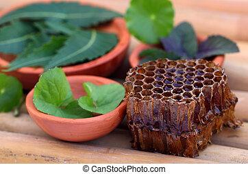 Hierbas medicinales con peine de miel