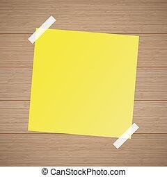 Hoja amarilla de una libreta grabada en el fondo de madera