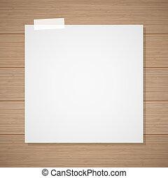 Hoja blanca de una libreta grabada en el fondo de madera