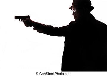 Hombre con silueta de pistola