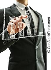 Hombre de negocios apuntando al gráfico