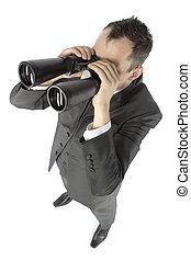 Hombre de negocios con prismáticos