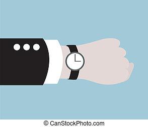 Hombre de negocios con un reloj negro