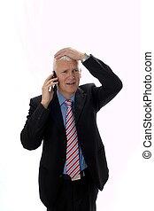 Hombre de negocios decepcionado llamando a Mano en la cabeza