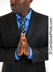 Hombre de negocios rezando