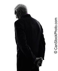 Hombre de negocios triste silueta trasera