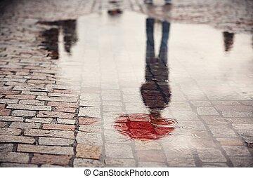 Hombre en días lluviosos