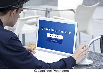 Hombre joven con la computadora portátil y el sitio web de la banca online