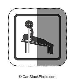 Hombre practicando pesas tumbado en icono