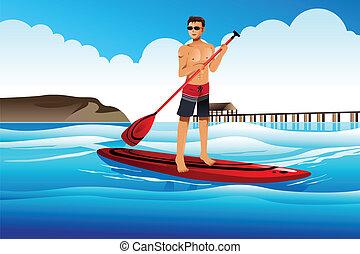 Hombre remando en el océano