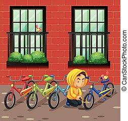 Hombre robando bicicleta delante del edificio