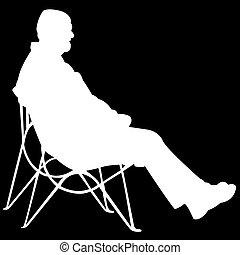 Hombre sentado en un fondo negro