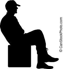 Hombre silueta sentado en una silla de fondo blanco