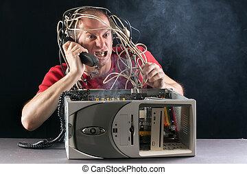 Hombre y computadora ardiendo