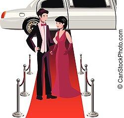 Hombre y mujer en una alfombra roja.