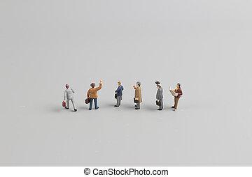 Hombres de negocios que coleccionan mundos de Minia Tures