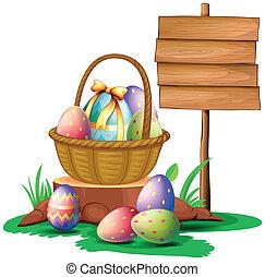 Huevos de Pascua cerca de un cartel de madera